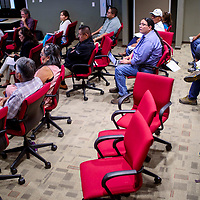 Attendees listen to presentations during the Navajo Nation Human Rights Commission Environmental Justice Symposium at the Navajo Department of Transportation complex in Window Rock Wednesday.
