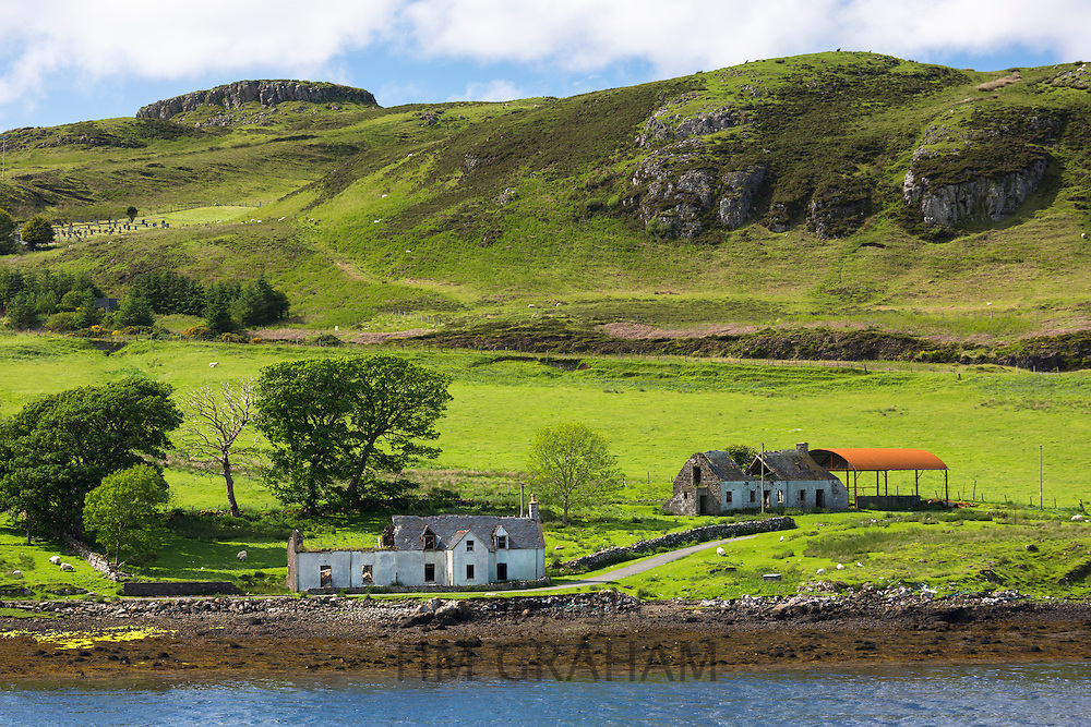 Derelict abandoned  croft farm with disused Dutch barn at Struan on Isle of Skye in the Highlands and Islands of Scotland