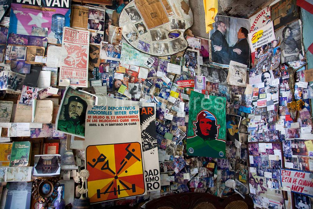 Book and vinyl record shop, with pictures of Che Guevara and revolutionary material, Santiago de Cuba, Cuba.