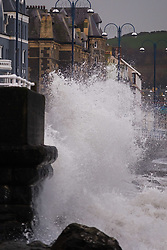 © Licensed to London News Pictures. 10/11/2018. Aberystwyth, UK. A wild, wet and stormy morning in Aberystwyth, with huge waves at high tide breaking along the promenade and sea defences of the coastal town on Cardigan Bay, west Wales.Photo credit: Keith Morris/LNP
