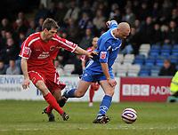 Photo: Tony Oudot/Richard Lane Photography. <br /> Gillingham Town v Carlisle United. Coca-Cola League One. 21/03/2008. <br /> Danny Cullip of Gillingham beats Scott Dobie of Carlisle to the ball
