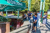 Borjomi , Georgia - August 12, 2019 : Tourists  people drinking  Borjomi mineral water Samtskhe Javakheti region Georgia eastern Europe