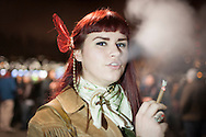 December 6, 2012. Seattle, Washington. Washington and Colorado became the first states to vote to decriminalize and regulate the possession of an ounce or less of marijuana by adults over 21. Pictured at a 'Stash Mob' gathering in Seattle is Jenna (21), smoking marijuana in public.....Photo © John Chapple / www.JohnChapple.com