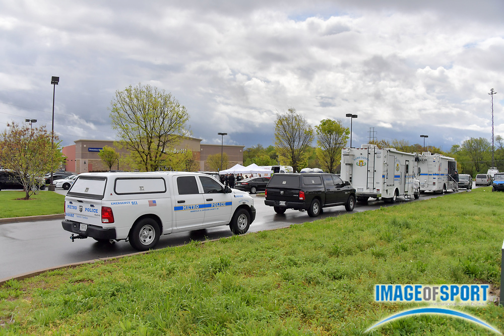 Law enforcement vehicles near the command center across from the Waffle House on Murfreesboro Road on Monday, April 23, 2018 in Nashville, Tenn. where a shooting occurred on Sunday morning. Travis Reinking is the suspect in the shooting at the Waffle House restaurant Sunday in Nashville that resulted in the death of four people. Reinking is now in the custody of the Metro Nashville Police following a search lasting over 24 hours. (Jim Brown\IOS via AP)