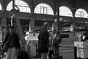 Passengers wait for a train in the train station Paris, France