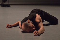 """© Licensed to London News Pictures. 09/10/2015. London, UK. Pictured: Nick Bryson performing. Robin Dingemans & Nick Bryson's """"The Point At Which It Last Made Sense"""" is performed at the Lilian Baylis Studio at Sadler's Wells on 9 October 2015. Performers: Nick Bryson, Michael Turinsky and Marlieke Burghouts. Photo credit: Bettina Strenske/LNP"""