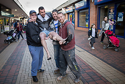 © Licensed to London News Pictures . Wythenshawe , Manchester , UK . FILE PICTURE DATED 23/03/2015 of WAYNE PHILIPPS ( 40 , from Wythenshawe ) with friends at Wythenshawe Precinct . Phillips , who is currently (20th November 2015) working as a self-employed DPD delivery driver , became famous after pranking TV adverts and performing gags and stunts on YouTube and Vine , including a spoof of the Money Supermarket advert which he acted out in high heels and short shorts , near to his home , at Wythenshawe Precinct , in South Manchester and which went viral . Photo credit : Joel Goodman/LNP