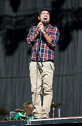 © Licensed to London News Pictures. 26/08/2011. Reading, UK. The Deftones play Day one of Reading Festival 2011 in Reading, Berkshire today (26/08/2011). Pictured is lead singer Chino Moreno Photo credit: Ben Cawthra/LNP