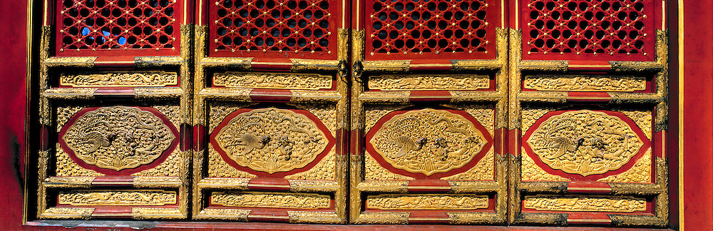 Ancient lacquered doors shield the Hall of Perfect Harmony, or Zhonghedian Hall in the Forbidden City, Beijing, China, from curious eyes.