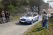 France, April 13th 2014: A FDJ team car passes through Pont Gibus during the Paris Roubaix 2014 cycle race near Wallers.