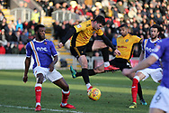 Padraig Amond of Newport county © and Joss Labadie of Newport county (4) get to the ball ahead of Troy Archibald-Henville of Exeter (l). EFL Skybet football league two match, Newport county v Exeter City  at Rodney Parade in Newport, South Wales on New Years Day, Monday 1st January 2018.<br /> pic by Andrew Orchard,  Andrew Orchard sports photography.