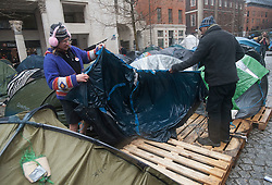 © Licensed to London News Pictures. 22/02/2012. London, UK. Two members of the Occupy group removing a tent from the Occupy London Stock Exchange site in front of St Paul's Cathedral on February 22nd 2012. Protesters at the site have been refused permission to appeal against their eviction from the Occupy London camp. Photo credit : Ben Cawthra/LNP