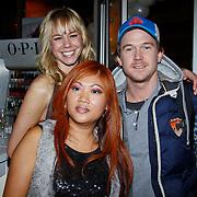 NLD/Amsterdam/20101122 - Inloop 10 jarig jubileum Cybersalon, Nicolette Kluijver en Johnny de Mol met eigenaresse Angela Riksten