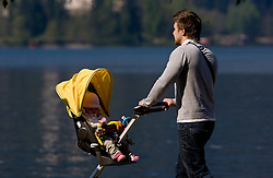 Father with a child, on April 25, 2010, at Lake Bled, Bled, Slovenia. (Photo by Vid Ponikvar / Sportida)