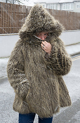 © Licensed to London News Pictures 07/02/2021.        Orpington, UK. A woman wearing her winter faux fur coat in a snow blizzard in Orpington, South East London. Photo credit:Grant Falvey/LNP