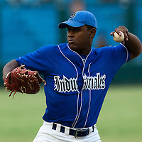 15 February 2009: First base Alexander Mayeta of the Occidentales throws the ball during a training game of Cuba Baseball Team for the World Baseball Classic 2009. The national team is pitted against itself, divided in two teams called the Occidentales and the Orientales. The Orientales win 12-8, at the Latinoamericano stadium, in la Habana, Cuba.