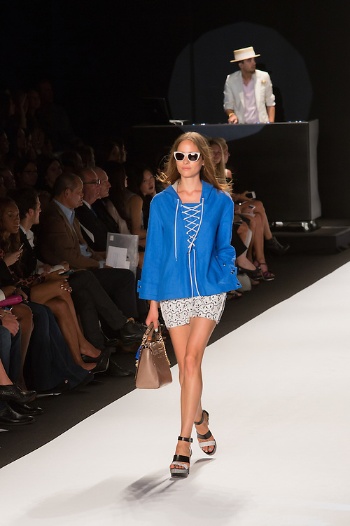 White nd gray print shorts and a bright blue hooded pullover jacket with white lace tie.