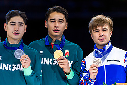 13-01-2019 NED: ISU European Short Track Championships 2019 day 3, Dordrecht<br /> (L-R) Shaoang Liu and Shaolin Sandor Liu of Hungary and Semen Elistratov of Russia pose in the Men's overall classification medal ceremony during the ISU European Short Track Speed Skating Championships