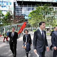 Nederland, Amsterdam , 15 mei 2014. <br /> Minister-president Rutte opende donderdag 15 mei de Nederlandse vestiging van de Europese Investeringsbank (EIB) in Amsterdam. <br /> Pim van Ballekom, vice-president (l)  en rechts Werner Hoyer, de president van de EIB. <br /> Aankomst van de Rutte en Van Ballekom.De EIB is het financieringsinstituut van de Europese Unie.<br /> De 28 lidstaten zijn aandeelhouder. De bank is opgericht in 1958 bij het Verdrag van Rome en heeft als doel projecten te financieren die zijn gericht op de versterking van de Europese economie.<br /> Prime Minister Rutte (m) opened Thursday, May 15th, the Dutch branch of the European Investment Bank (EIB) in Amsterdam. Left Pim van Ballekom, Vice-President of the EIB and right Werner Hoyer, president.<br /> <br /> The EIB is the financing institution of the European Union.<br /> Arrival of Rutte and Van Ballekom.