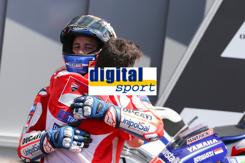 Ducati's Team rider Italian Andrea Dovizioso (C), winner, Movistar Yamaha's Spanish rider Maverick Vinales (L), second, and OCTO Pramac Yakhnich's Italian rider Danilo Petrucci, third, celebrate on the podium after winning the Moto GP Grand Prix at the Mugello race track on June 4, 2017. Ducati's Andrea Dovizioso thrilled the home crowds with a stirring MotoGP victory at Mugello on Sunday that saw him edge championship leader Maverick Vinales. Another Italian, Danilo Petrucci, was third while veteran superstar Valentino Rossi of Yamaha won plaudits for racing in pain from a training accident and finishing fourth having set the early pace.<br /> Photo by Danilo D'Auria.<br /> Danilo D'Auria/UK Sports Pics Ltd/Alterphotos