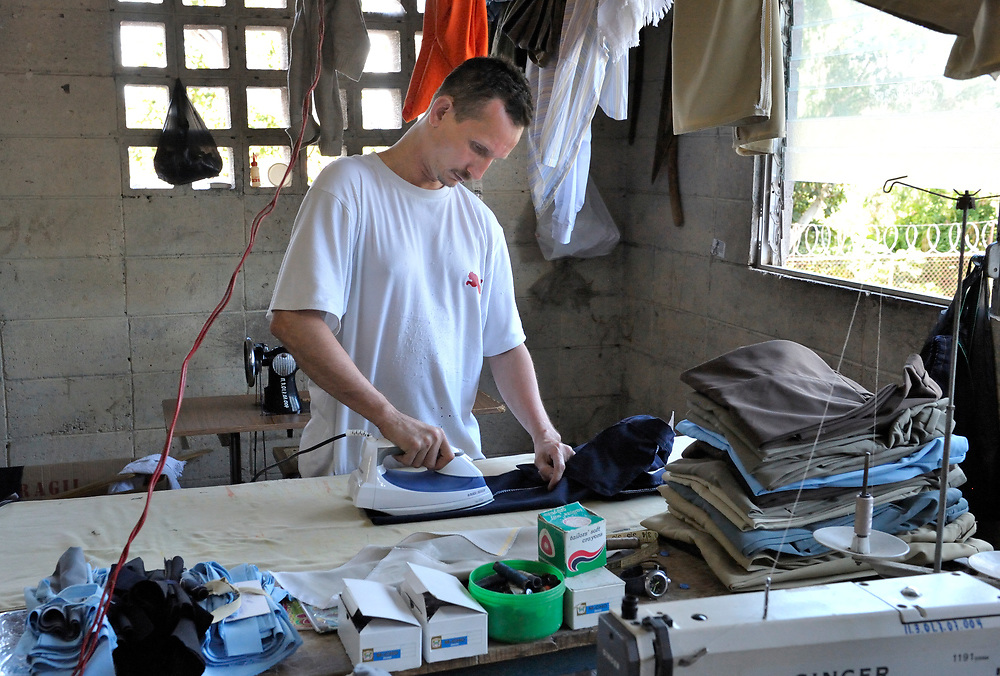 A prisoner makes clothing to earn money in a prison in Sensuntepeque, El Salvador.