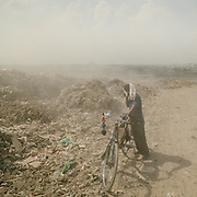 The Ghazipur open air garbage dump in Delhi. The constantly burning garbage creates toxic fumes that spread through the city.<br /> Garbage trucks can carry 3T and do about 800 trips a day.<br /> India