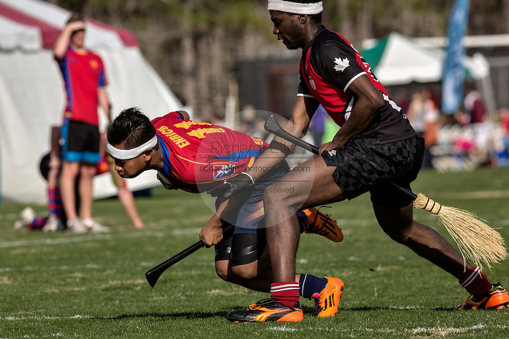 A member of the University of Sydney in action against McGill University during the Quidditch World Cup on April 5, 2014 in Myrtle Beach, South Carolina. The sport, created from the Harry Potter novels is a co-ed contact sport with elements from rugby, basketball, and dodgeball. A quidditch team is made up of seven athletes who play with broomsticks between their legs at all times.