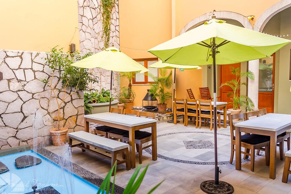 Courtyard of the beautiful Casa Lucila boutique hotel, Olas Atlas No. 16, Centro, Mazatlan, Mexico