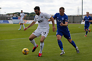 Cove Rangers' Ross Draper (14) and Peterhead's Scott Brown (8) battles for possession, tussles, tackles, challenges,during the Premier Sports Scottish League Cup match between Peterhead and Cove Rangers at Balmoor, Peterhead, Scotland on 17 July 2021.