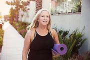 Mature women walking to yoga class