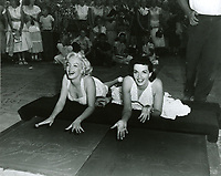 1953 Marilyn Monroe and Jane Russell at their hand and footprint ceremony at Grauman's Chinese Theatre