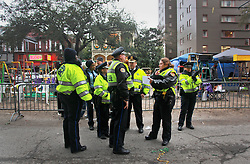 17 Feb 2015. New Orleans, Louisiana.<br /> Early morning Mardi Gras Day. New orleans Police officers (NOPD) prepare for duty on St Charles Avenue before the big parades start to roll. <br /> Photo; Charlie Varley/varleypix.com