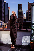 Woman screaming on a Manhattan rooftop.