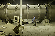 At the furnace..The only Phosphate plant in operation on Nauru...Nauru, officially the Republic of Nauru is an island nation in Micronesia in the South Pacific.  Nauru was declared independent in 1968 and it is the world's smallest independent republic, covering just 21square kilometers..Nauru is a phosphate rock island and its economy depends almost entirely on the phosphate deposits that originate from the droppings of sea birds. Following its exploitation it briefly boasted the highest per-capita income enjoyed by any sovereign state in the world during the late 1960s and early 1970s..In the 1990s, when the phosphate reserves were partly exhausted the government resorted to unusual measures. Nauru briefly became a tax haven and illegal money laundering centre. From 2001 to 2008, it accepted aid from the Australian government in exchange for housing a Nauru detention centre, with refugees from various countries including Afghanistan and Iraq..Most necessities are imported on the island..Nauru has parliamentary system of government. It had 17 changes of administration between 1989 and 2003. In December 2007, former weight lifting medallist Marcus Stephen became the President.