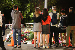 March 16, 2019 - Christchurch, New Zealand - Mourners still flow beside the police cordon to pay respect to the victims of the Christchurch mosques shooting on Deans Avenue after 10pm tonight. Around 50 people has been reportedly killed a terrorist attack on two Christchurch mosques. (Credit Image: © Adam Bradley/SOPA Images via ZUMA Wire)