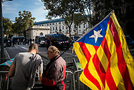 Men with in a catalan flag is seen at the gats of Ciutadella Park where the Catalan Parlament is. The park was closed by the Mossos d'Esquadra for safety reasons.