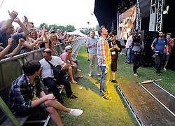 © licensed to London News Pictures. LONDON. UK.  03/07/11. Jamie Oliver watches Athlete headline at Jamie Oliver's 'The Big Feastival' . Jamie Oliver's The Big Feastival, is a three day event featuring food from some of the country's top chefs along with live music. The Big Feastival takes place on Clapham Common on the 1st, 2nd and 3rd July. All profits from the event will be shared between The Jamie Oliver Foundation and The Prince's Trust.  Mandatory Credit Stephen Simpson/LNP