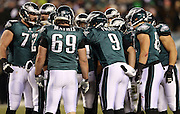 The Philadelphia Eagles offense huddles and calls a play during the NFL NFC Wild Card football game against the New Orleans Saints on Saturday, Jan. 4, 2014 in Philadelphia. The Saints won the game 26-24. ©Paul Anthony Spinelli