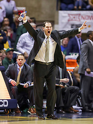 Mar 7, 2020; Morgantown, West Virginia, USA; Baylor Bears head coach Scott Drew yells from the bench during the second half against the West Virginia Mountaineers at WVU Coliseum. Mandatory Credit: Ben Queen-USA TODAY Sports