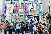 """The NUT leads a national strike action in England and Wales. Marches and rallies are being held around the country, including this one from Broadcasting House to Downing Street, Whitehall. The union says the action is being taken against: Excessive workload and bureaucratic; Performance related pay and in defence of a national pay scale system; Unfair pension changes. Christine Blower, General Secretary of the National Union of Teachers, the largest teachers' union said: """"Teachers deeply regret the disruption caused by this strike action to parents and teachers. The Government's refusal, however, to engage to resolve the dispute means that we have no alternative other than to demonstrate the seriousness of our concerns.<br /> """"Teachers' levels of workload are intolerable –the Government's own survey, published last month, shows that primary school teachers work nearly 60 hours a week and secondary school teachers work nearly 56 hours a week. 2 in 5 teachers are leaving the profession in the first 5 years of teaching as are many others.  This is bad for children and bad for education. London, UK 26 March 2014.<br />  Guy Bell, 07771 786236, guy@gbphotos.com"""