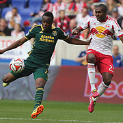Steve Zakuani, (left), Portland Timbers, prepares to shoot while challenged by Chris Duvall, New York Red Bulls, during the New York Red Bulls Vs Portland Timbers, Major League Soccer regular season match at Red Bull Arena, Harrison, New Jersey. USA. 24th May 2014. Photo Tim Clayton