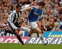 Photo: Leigh Quinnell.<br /> Birmingham City v Newcastle United. The Barclays Premiership. 29/04/2006. Newcastles Nolberto Solano pushes Birminghams Martin Taylor off the ball.