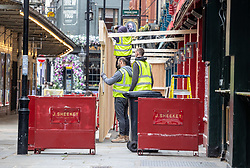 © Licensed to London News Pictures. 07/04/2021. London, UK. With less than 5 days before the great unlock-down, workmen at the famous West End seafood restaurant J Sheekey in Covent Garden, London are in full swing preparing outdoor seating facilities. This week Prime Minister, Boris Johnson announced that pubs, shops, gyms and hairdressers will be allowed to open to the public from this Monday, 12th April 2021 as England takes its first big steps out of the coronavirus pandemic restrictions. Photo credit: Alex Lentati/LNP