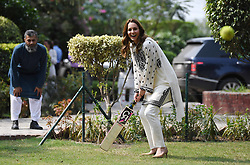 File photo dated 18/10/19 of the Duchess of Cambridge playing cricket during a visit to the SOS Village at Lahore in Pakistan. The Duchess of Cambridge celebrates her 38th birthday today.