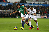 Ahmed Hegazi of West Bromwich Albion holds off Jordan Ayew of Swansea city.. Premier league match, Swansea city v West Bromwich Albion at the Liberty Stadium in Swansea, South Wales on Saturday 9th December 2017.<br /> pic by  Andrew Orchard, Andrew Orchard sports photography.