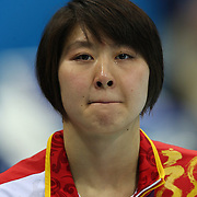 Liuyang Jiao, China, crying after receiving her Gold Medal after winning the Women's 200m Butterfly Final at the Aquatic Centre at Olympic Park, Stratford during the London 2012 Olympic games. London, UK. 1st August 2012. Photo Tim Clayton
