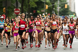 NYRR Mini 10K road race (40th year); lead pack of elite runners at start of race