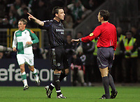 Photo: Paul Thomas.<br /> Werder Bremen v Chelsea. UEFA Champions League, Group A. 22/11/2006.<br /> <br /> John Terry (L) has words to the referee Lubos Mikel after Werder Bremen score.