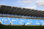 Groundsmen tend to the pitch after the crowd have gone home. Barclays Premier league, Cardiff city v Everton at the Cardiff city Stadium in Cardiff,  South Wales on Saturday 31st August 2013. pic by Andrew Orchard,  Andrew Orchard sports photography,