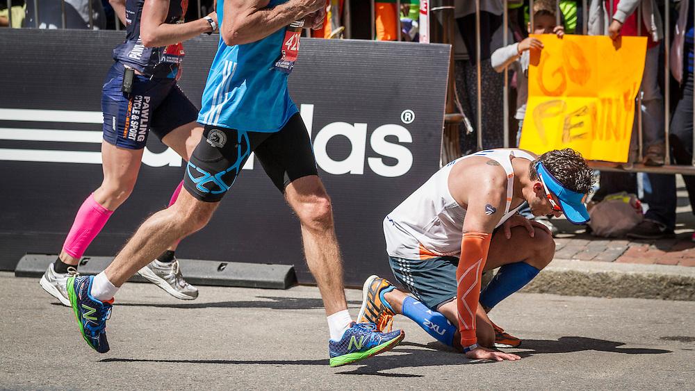 2014 Boston Marathon: runner drops to pavement